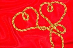 穿线在红色缎 免版税库存照片