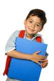 穿蓝衣的男孩文件夹 免版税库存图片