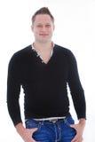 穿长的袖子T恤杉的可爱的年轻人 免版税库存图片