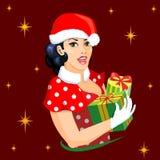 穿戴在圣诞节样式的画报女孩,举行出席 库存图片