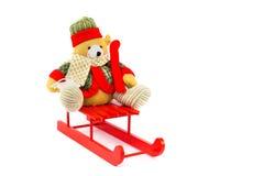 穿戴的圣诞节涉及红色木雪橇 库存照片