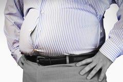 穿紧的正式衬衣的一个肥胖人的中央部位  库存照片