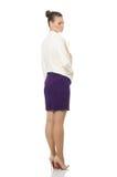 穿紫色礼服的俏丽的模型隔绝在白色 库存照片