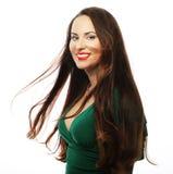 穿绿色礼服的年轻美丽的妇女 图库摄影