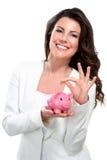 突出与存钱罐星期一的新美丽的妇女 免版税库存图片
