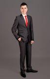 突出在灰色背景的新生意人 免版税库存照片