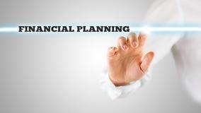 突出财政规划词的手指 免版税库存图片