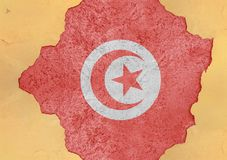 突尼斯崩裂了孔和残破的旗子在大具体物质门面 库存照片