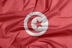 突尼斯的织品旗子 突尼斯旗子背景折痕  库存照片