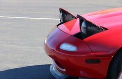 突然出现在红色Miata的车灯 库存照片