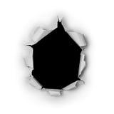 突破在粗砺的纸张的被撕毁的大黑洞 免版税库存图片