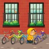 窃取在大厦前面的人自行车 向量例证