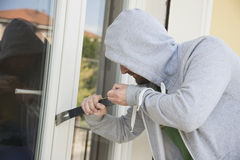 窃取的夜贼在家 免版税库存照片