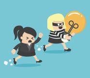 窃取从另一名女实业家的窃贼电灯泡 库存照片