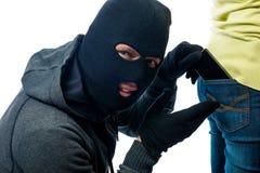 窃取从后面口袋牛仔裤的电话 库存图片