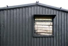 窗口和波状钢墙壁 免版税库存照片