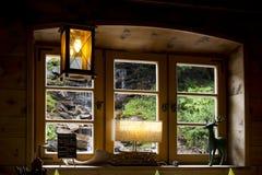 从窗口看见的瀑布 免版税图库摄影