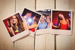立即照片的综合图象在木地板上的 免版税库存照片