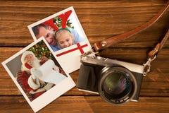 立即照片的综合图象在木地板上的 库存图片