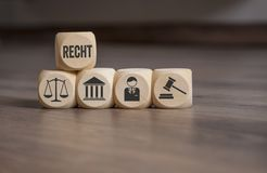 立方体和模子与法律标志 图库摄影
