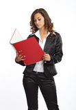 站立与文件夹的女商人 图库摄影