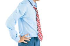 站立与两手插腰的男服长的袖子衬衣与截去pa 库存图片