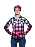 站立与在腰部的胳膊的严肃的妇女 免版税库存照片