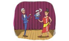 站立与微笑的面孔的魔术师和他的辅助女孩 Mou 库存图片
