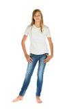 站立与白色T恤杉和蓝色牛仔裤的女孩在白色 免版税库存照片
