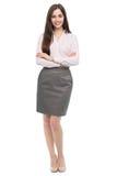 站立与胳膊的年轻女商人画象横渡 免版税库存图片