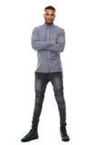站立与胳膊的年轻非裔美国人的人横渡 免版税库存照片