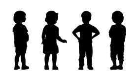 站立剪影的孩子设置了7 免版税库存照片