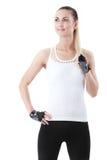 站立反对白色背景的体育样式的健身妇女 免版税图库摄影