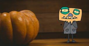 站立在万圣夜南瓜旁边的妖怪动画片 库存图片