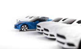 站立在几辆其他玩具汽车中的玩具汽车 免版税库存照片