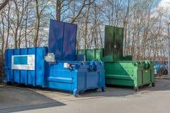 站立在医院站点的2台大垃圾压紧机 免版税库存照片