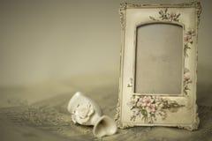站立在图画的照片框架 免版税库存图片