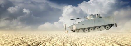 站立在坦克前面的男孩 图库摄影