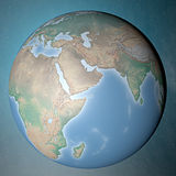 站立在干净的空间中东的地球 免版税库存图片