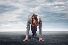 站立在开始状态的女实业家 免版税库存照片