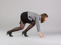站立在开始状态的女实业家 免版税库存图片