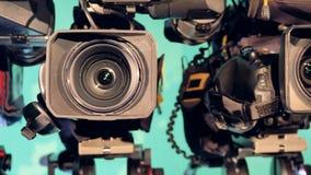 站立在彼此附近的录影机行在演播室 股票录像