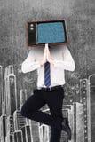 站立在树姿势的微笑的商人的综合图象 库存图片