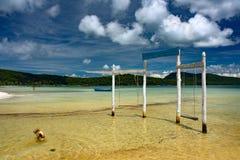 站立在水中的原始和时髦的木摇摆 库存照片