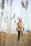 站立在沼泽地的妇女 库存照片