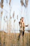 站立在沼泽的成熟妇女 免版税库存照片