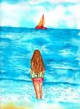 站立在海岸线观看的帆船的女孩 免版税图库摄影