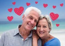 站立在海滩的资深夫妇画象  库存图片