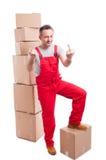 站立在箱子的搬家工人人显示淫秽姿态 图库摄影