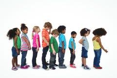 站立在线的小组孩子 免版税图库摄影